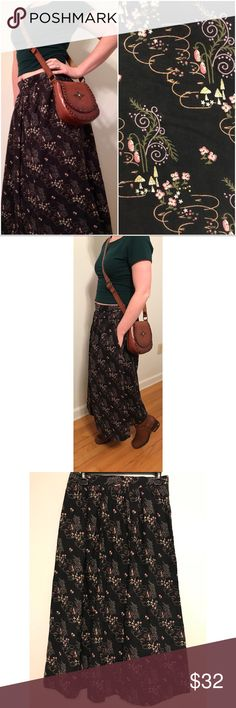 """Vintage Mushroom Floral Print Black Maxi Skirt S Oh my goodness!!! This piece is incredible! You will be summer festival ready (also can transition into any other season) in this mushroom and floral print skirt AND it has pockets!!! It also has a zip and button back and a triangular band in the front that is very flattering to the waist. It falls to the ankles or right above depending on height. This piece will not last long. Tag says 12 but would fit a size S.   Waist- 14.5"""" vintage Skirts…"""