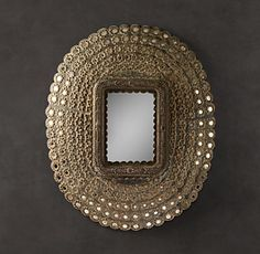 """RH's Peacock Mirror:Inspired by the fanned tail feathers of a peacock – known as """"the bird with a hundred eyes"""" – our mirror's hand-carved wood frame is dotted with row upon row of aged nickel-silver glass. Skilled artisans inset the tiny mirrors with care, creating a detailed accent that reflects light from every angle."""
