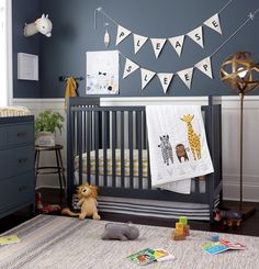 View the safari themed boys nursery at The Land of Nod to find design ideas and inspiration for the perfect nursery. Browse boys nursery ideas.