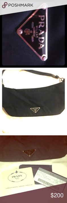 🏷Authentic 👑 PRADA black HANDBAG. NWT. Authentic 👑 PRADA Nylon Leather Strap Hobo Handbag 👑PRADA black HANDBAG PURSE.👑 AUTHENTIC (See photos of the tags/card). CONDITION--never been used ! Bundle or offer please and we can work out a deal! 😊🎁👑 Prada Bags Clutches & Wristlets🎉 Prada Bags Clutches & Wristlets