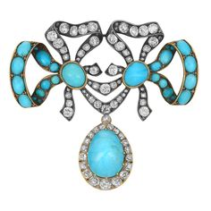 "Antique Silver, Gold, Turquoise and Diamond Bow Brooch -  The stylized double bow centering two diamond-set ribbons, flanked by two ribbons set throughout with 24 oval and round cabochon turquoises, suspending one pear-shaped cabochon turquoise approximately 16.0 x 12.0 mm., surrounded by diamonds, totaling 50 old-mine cut diamonds approximately 4.40 cts., pendant detachable, approximately 15.7 dwt.  2 1/4 x 2 7/16"" (with pendant). Bow 1 1/4 x 2 7/16""."
