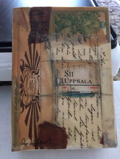 Encaustic collage by Amy Willcut made from vintage maps and papers bought in Sweden