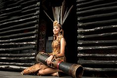 Dayak girl with ceremonial drum, Kalimantan (Borneo Island), beautiful places to visit in Indonesia.
