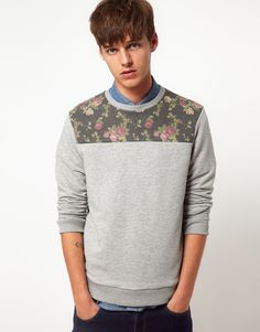 This sweatshirt by ASOS has been constructed in a cotton marl. It comes in a regular fit. The details include: ribbed crew neck, floral print on toke, textured finish throughout, ribbed hem and cuffs.
