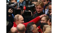 Russian figure skaters Yevgeny Plushenko and Yulia Lipnitskaya are congratulated by Russian president Vladimir Putin after winning gold in the team figure skating event.