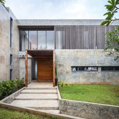 Architect Jun Sekino employed clean-lined geometric forms and patinated concrete walls to create a tropical take on modernist architecture for this house in Thailand's Tha Mai district. See the full story on dezeen.com/architecture #architecture #thailand Photograph by Spaceshift Studio.