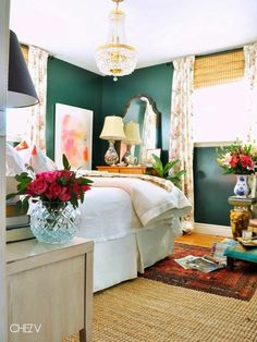 A Layered Retreat..love all the texture in this room and the dark green paint on the wall. Bedroom hone decor