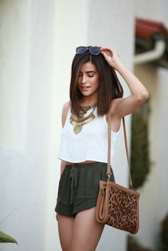 spring / summer - street chic style summer outfit ideas - leopard print shoulder bag + olive green drawstring shorts + white sleeveless top + golden statement necklace + leopard print sunglasses + brown ankle strap tassel heeled sandals