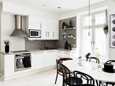 Black and white kitchen with small dining space