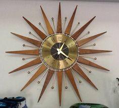Teak and brass mid-century starburst clock.