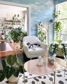 A painted cloud mural totally brightened up this plant-filled living room. The mural was completed using four Clare paint colors: Nairobi Blue, Frozen, Fresh Kicks, and Classic. Condo Living Room, Living Spaces, Living Rooms, Best Blue Paint Colors, Interior Styling, Interior Design, Urban, High Quality Furniture, Living Room Inspiration