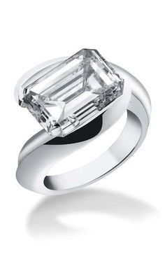 Alexandre Reza emerald cut engagement ring, set with a magnificent 7.67ct emerald cut diamond in white gold.