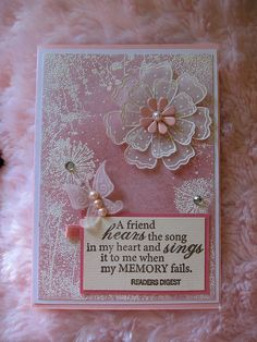 handmade card: Pinky flowers by tcvivi ... luv the vellum flower and the white embossing ... pink a & white ... sweet sentiment ...