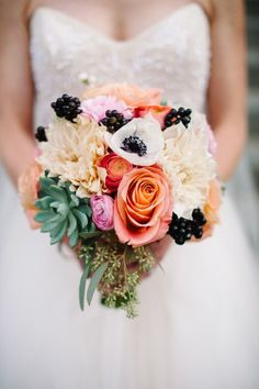 Colorful succulents, dahlias, roses, berries, and anemones | Reem Acra Eternity gown | Ali and Sam's Elegant Urban Denver Wedding