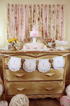 Love the fabric on the wall and the banner!  Frilly Tea Party Birthday PRINTABLE Custom Name Banner by Love The Day. $15.00, via Etsy.
