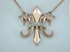 The Fleur De Lis in 14kt rose gold with diamonds $2900