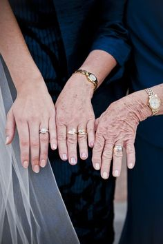 wedding rings of three generations// oh how I wish I had done this when my grandma was alive --- I saw a cooler shot with their hands on the boquet