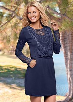 Taking a walk during fall weather in this dress. Venus embroidered detail dress.