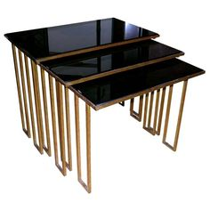 Jean Royère Black Opaline Top Nesting Tables | From a unique collection of antique and modern nesting tables and stacking tables at https://www.1stdibs.com/furniture/tables/nesting-tables-stacking-tables/