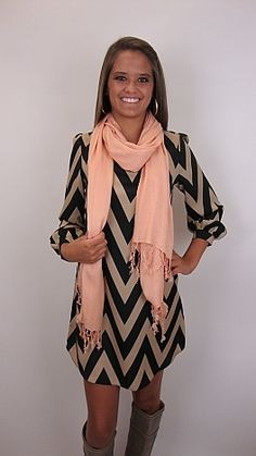 This dress is paired perfectly with a light pink scarf and boots:)