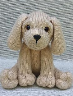 "Knitting Pattern for Puppy Love - This toy dog softie is knit in-the-round. Size sitting approx. 9 ½"" tall in worsted wt. (Aran/10-ply) yarn, using approx. 275 yds. Designed by Rainebo"