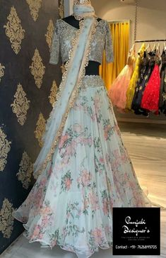 Check out the latest in style at Mrunalini Rao studio today.Calantha collection by Mrunalini Rao. Stunning ice blue color lehenga and blouse with net dupatta. Lehenga with floral print. Blouse with hand embroidery gold trhead work. Wedding Lehenga Designs, Designer Bridal Lehenga, Indian Bridal Lehenga, Indian Bridal Outfits, Indian Bridal Fashion, Indian Fashion Dresses, Indian Designer Outfits, Designer Dresses, Floral Lehenga