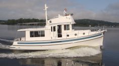 """Nordic Tugs Nordic Tug 39: The Nordic Tugs 39 has a LOA of 40' (12.19 m), a beam of 12'11"""" (3.9 m) and a draft of 4'4"""" (1.3 m)."""
