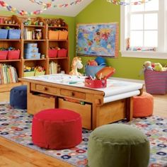 I bet Papa could build a cool table like this one for us.  (Someday when we have an art/homeschool room :)