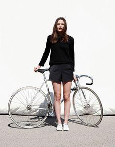 I Am In Like My Bike - white sneakers, black shorts