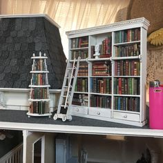 Made a bookshelf for all those little books, the little corner shelf was one that I had, simply painted it to match.