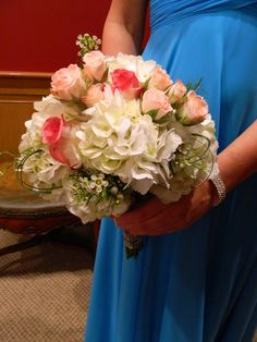 My prom bouquet! It looked great with my blue dress. Light pink roses, hot pink roses, and white hydrangeas. I got it from Changing Seasons in Brewton, AL.