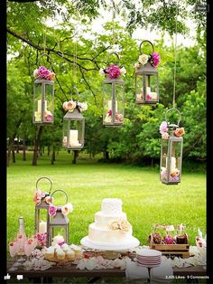 Change to white lanterns like further up the page filled with flowers that coordinate with bridal bouquets.
