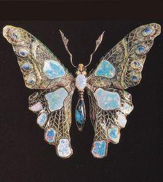 An Art Nouveau butterfly brooch in plique-à-jour enamel, set with opals and diamonds, France, circa 1900. Image source: Art Nouveau Jewelry by Vivienne Becker #ArtNouveau #brooch