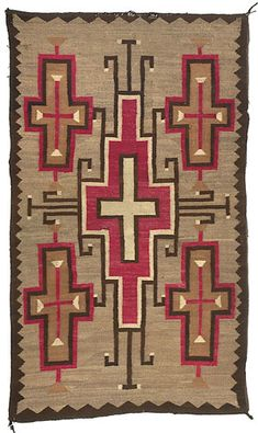 """Navajo .circa 1920-30. Woven in red, cream, natural brown and tan against a medium brown ground with a large central cross, linked with four others at corners of rug; 71"""" x 41."""""""