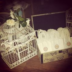 Our birdcage for cards and lolly bags in a suitcase for the candy buffet!