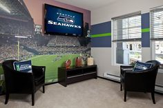 Residence 1 den and little home court for the Seahawk fan!