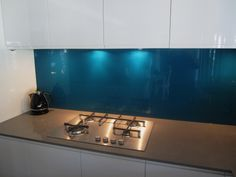 """This Laminex Metaline kitchen splashback in """"LAGOON METALLIC"""" contrasts beautifully with the gray finish of the kitchen cupboards. Working closely with our customers on their kitchen designs we love it when we see a beautifully finished product such as this one."""
