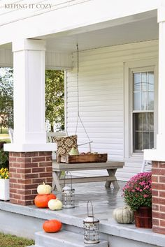 Oh my goodness! The columns with brick on the bottom are exactly how my Grandmom's front porch was complete with two steps up and clapboard house walls.