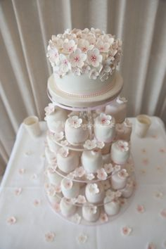 Individual blossom mini cakes tower from The Pretty Cake Company.