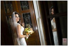 Gush…we love her.   Check out more >>> http://blog.nathanieledmunds.com/2013/12/18/sara-matt/  #Bride #Wedding #Marriage #Dress #White #Flowers #Bouquet #Wood #Window #Church