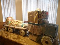 Semi-Truck Diaper Cake. Consist of Diapers, Baby wipes, Johnson & Johnson bath gift set, receiving blankets, towles and bibs.
