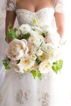 This incredible blush and ivory bouquet of peonies, Juliet garden roses, and vibrant greenery was created by Sunny Ravanbach of [White Lilac Inc](http://whitelilacinc.com/). The romantic, fresh style perfectly suits a seaside wedding.
