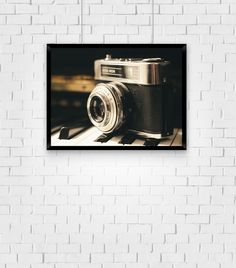 Camera on Piano Keys - Color Photographic Wall Art Print