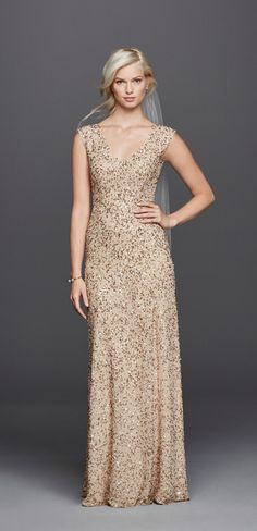 Sparkle and shine on your wedding day in this Wonder by Jenny Packham V-Neck Hand Beaded Sheath Wedding Dress