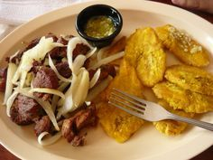 Carne Frita Con Tostones / Plantains with fried meat and onions, @Ruben Leikarnes Cafe in Isla Verde Puerto Rico
