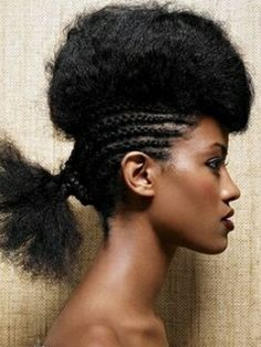 Stylish frohawk with longer hair. To learn how to grow your hair longer click here - http://blackhair.cc/1jSY2ux