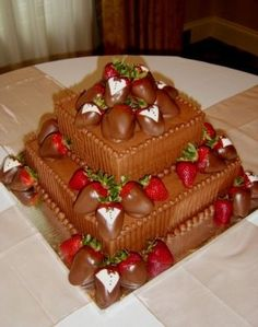 """10"""" and 6"""" square chocolate grooms cake, w/ pinstriping.  Chocolate  berries and tuxedo berries added."""