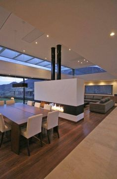 Love the windows in the ceiling extending the view and the double fireplace