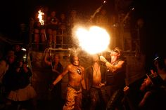 Festival-goers breathing fire during the festival.
