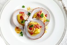 Flex your seafood skills with this stylish take on surf and turf: quickly caramelise scallops in a pan and present them in the shells with smashed corn and shards of prosciutto.